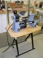 Lathe stand and plexi glass panel. This is ideal for demos.